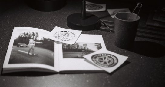 magazine and stickers with a cup of tea by the night light